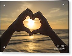 Hands Forming Heart Around Sunset Acrylic Print