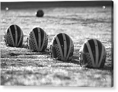 Helmets On Dew-covered Field At Dawn Black And White Acrylic Print