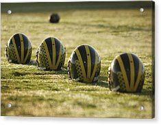 Helmets On Dew-covered Field At Dawn Acrylic Print