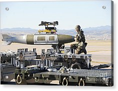 Irman Assists In Lowering A Guided Bomb Acrylic Print by Stocktrek Images