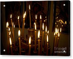 lit Candles in church  Acrylic Print by Danny Yanai