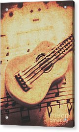 Little Carved Guitar On Sheet Music Acrylic Print by Jorgo Photography - Wall Art Gallery