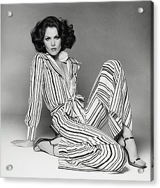 Lois Chiles Wearing A Striped Pajama And Blouse Acrylic Print by Francesco Scavullo