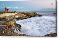 Long Exposure Of Waves Against The Cliff With Lighthouse In Shot Acrylic Print