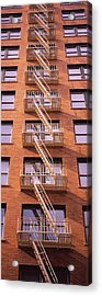 Low Angle View Of Fire Escape Ladders Acrylic Print