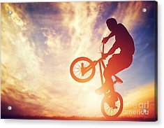 Man Riding A Bmx Bike Performing A Trick Against Sunset Sky Acrylic Print