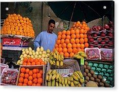 Market Vendor Selling Fruit In A Bazaar Acrylic Print by Sami Sarkis