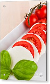 Mozzarella Salad With Tomatoes And Basil On A Wooden Table Acrylic Print
