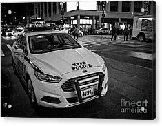 nypd ford fusion police cruiser parked on the street at night New York City USA Acrylic Print