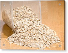 Oat Flakes Spilled Out Of Plastic Container  Acrylic Print by Arletta Cwalina
