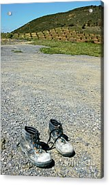 Old Pair Of Worn Out Boots Sitting On Stony Asphalt Acrylic Print by Sami Sarkis