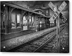 Old Train Station With Crossing Sign In Black And White Acrylic Print