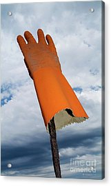 Orange Rubber Glove On A Wooden Post Against A Cloudy Sky Acrylic Print by Sami Sarkis