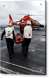 Personnel Carry An Injured Sailor Acrylic Print by Stocktrek Images