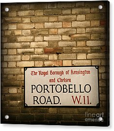Portobello Road Sign On A Grunge Brick Wall In London England Acrylic Print by ELITE IMAGE photography By Chad McDermott