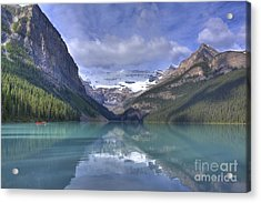 Red Canoe On Lake Louise Acrylic Print by Larry Whiting