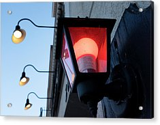 Red Light On The Wall With A Blue Sky And Yellow Bulbs In Holland Michigan Acrylic Print