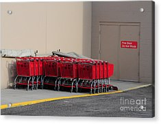 Red Shopping Carts In A Row Acrylic Print by Merrimon Crawford