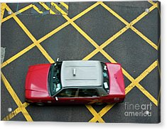 Red Taxi Cab Driving Over Yellow Lines In Hong Kong Acrylic Print by Sami Sarkis