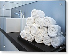 Rolled Towels Stacked In The Shape Of A Pyramid Acrylic Print by Larry Washburn