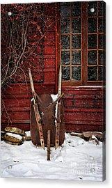 Rusty Wheelbarrow Leaning Against Barn In Winter Acrylic Print