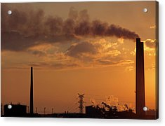Silhouetted Smoking Chimney At Sunset Acrylic Print by Sami Sarkis