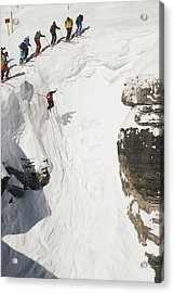 Skilled Skiers Plunge More Than 15 Feet Acrylic Print by Raymond Gehman