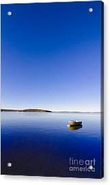 Small Boat Anchored Out To Sea Acrylic Print by Jorgo Photography - Wall Art Gallery