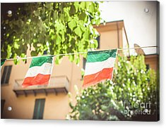 small Italian flags hanging by a thread Acrylic Print by Luca Lorenzelli