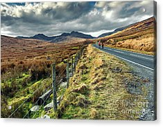 Snowdon Cyclists Acrylic Print by Adrian Evans