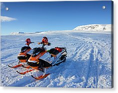 Snowmobiles In Iceland In Winter Acrylic Print by Matthias Hauser