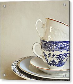Stacked Blue And White China Cups And Saucers. Acrylic Print by Lyn Randle