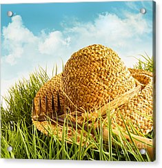 Straw Hat On Grass With Blue Sky  Acrylic Print by Sandra Cunningham