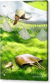 Straw Hat With Brown Ribbon Laying On Hammock Acrylic Print