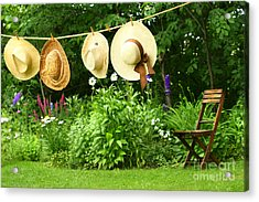 Summer Straw Hats Hanging On Clothesline Acrylic Print by Sandra Cunningham
