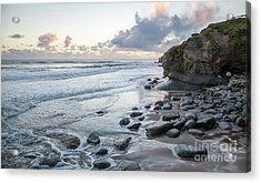 Sunset View In The Distance With Large Rocks On The Beach Acrylic Print