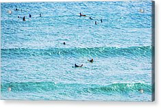 Surfers In The Ocean Acrylic Print by Jera Sky