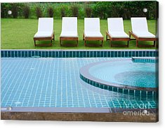Swimming Pool And Chairs Acrylic Print by Atiketta Sangasaeng