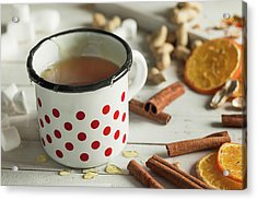 Tea In A Dotted Mug On White Background Acrylic Print by Denes Demeter