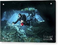 Technical Divers Enter The Cavern Acrylic Print by Karen Doody