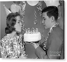 Teen Girl Blowing Out Birthday Candles Acrylic Print by H. Armstrong Roberts/ClassicStock
