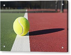 Tennis Ball Sitting On Court Acrylic Print by Thom Gourley/Flatbread Images, LLC