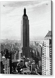 The Empire State Building Under Construction Acrylic Print by Jon Neidert