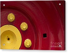 Three Yellow Nuts On A Red Wheel Acrylic Print by Wendy Wilton