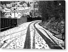 Tire Tracks In The Snow Acrylic Print by John Rizzuto
