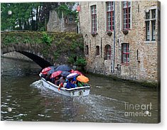 Tourists With Umbrellas In A Sightseeing Boat On The Canal In Bruges Acrylic Print