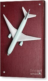 Acrylic Print featuring the photograph Toy Airplane Over Red Book Cover by Edward Fielding
