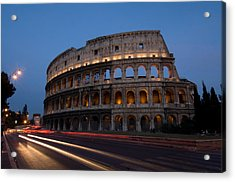Traffic Goes By The Colosseum At Night Acrylic Print by Joel Sartore