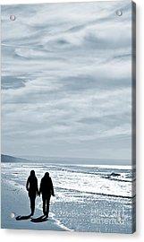 Two Women Walking At The Beach In The Winter Acrylic Print by Jose Elias - Sofia Pereira