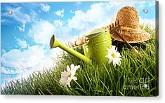 Water Can And Straw Hat Laying In Grass Acrylic Print by Sandra Cunningham